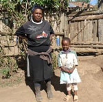 Mary and her mother are experiencing the health benefits of improved hand washing at school and home thanks to a WASHplus workshop at her ECD.
